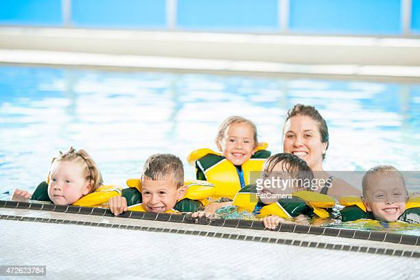 Children Lined Up in a Pool