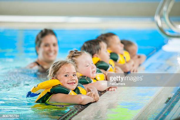 Children Lined up in the Public Pool