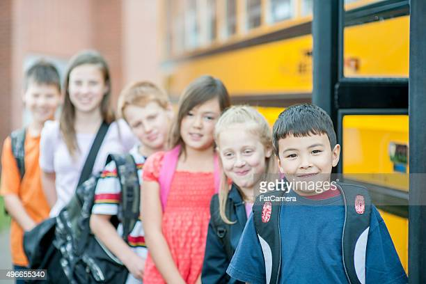 Children Lined Up Outside the Bus