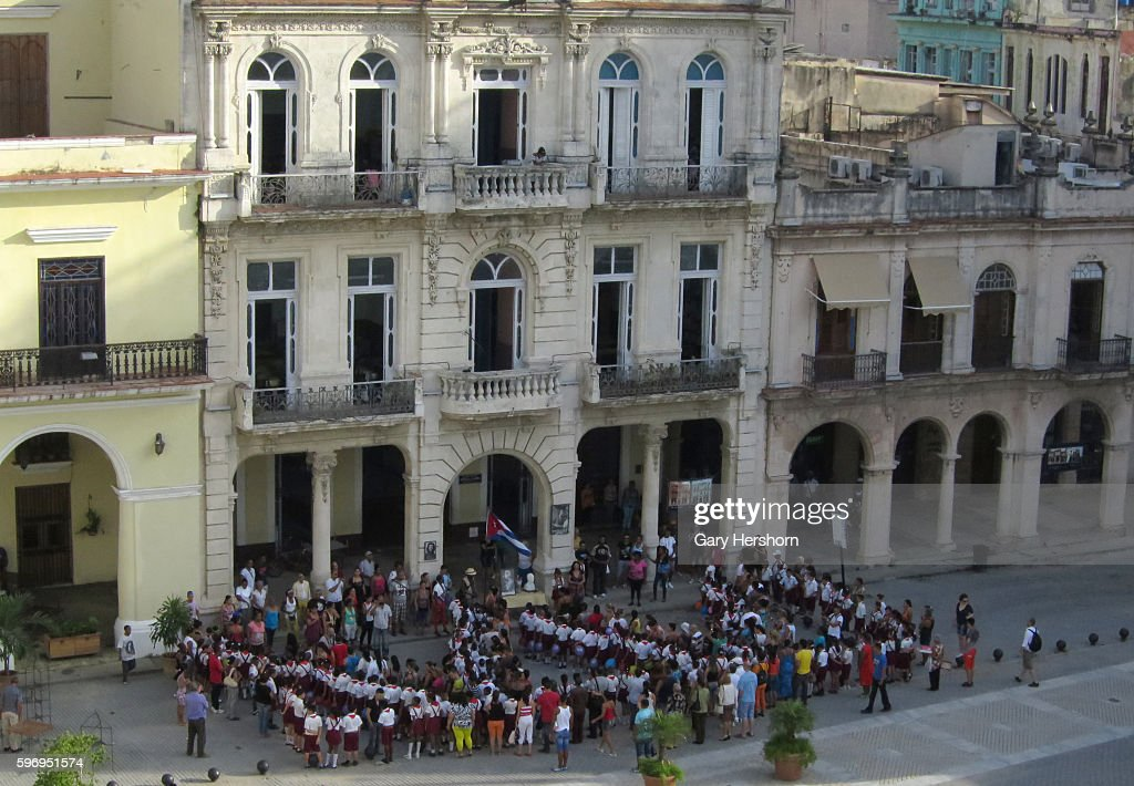 Children lineup to go into a school in Plaza Vieja in the old city in Havana Cuba October 8 2014