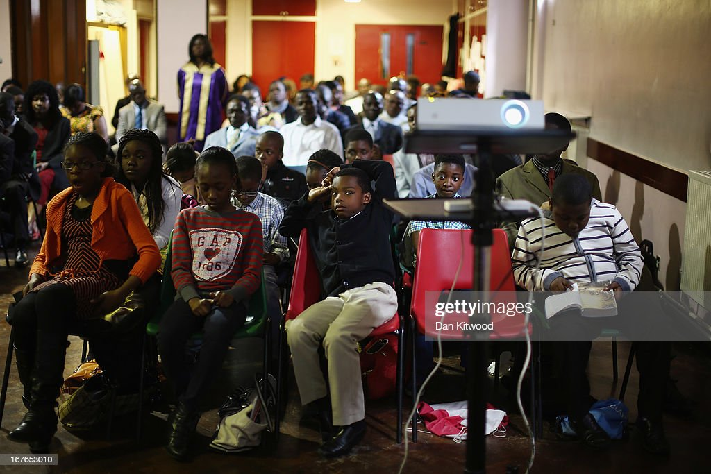 Children listen during a 'Seventh Day Evangelist' service at Crossway Church in the Heygate Estate on April 27, 2013 in London, England. The Crossway Church is an international church, with the congregation made up of native Londoners as well as people from Ghana, Jamaica, South Africa, Zimbabwe, Korea, Brazil, Eastern Europe and the United States. It has been serving the local community at different sites around Elephant and Castle for almost 150 years. The church has been at it's current location in the Heygate estate since 1974. The Heygate estate in central London was built in 1974 as social housing and housed around 3000 people, but fell into a state of disrepair, gaining a reputation for crime and poverty. The estate is due to be demolished as part of the £1.5billion GBP 'Elephant & Castle regeneration scheme', and replaced with 2,500 affordable new homes. The area has become popular with street artists, storytellers, and guerilla gardeners and attracts an array of urban wildlife including bats, birds and mammals.