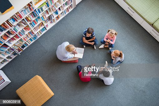 Children listening a fairy tale : Foto de stock