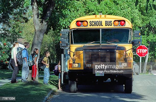 Children loading a school bus