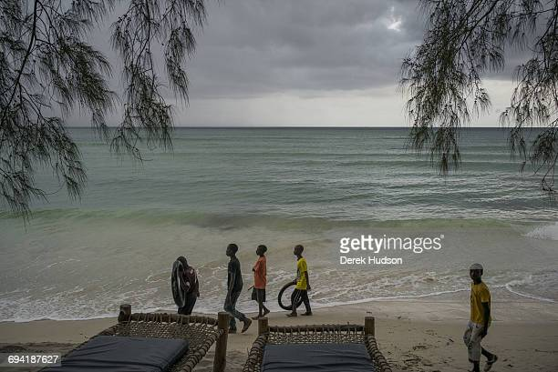 Children local to the small fishing town and constituency of Msambweni pictured playing in the high tide of the Indian ocean a short distance from...