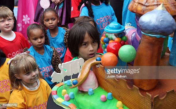 Children look at a candy cake after playing the world's largest game of Candyland August 19 2009 in San Francisco California San Francisco's famed...