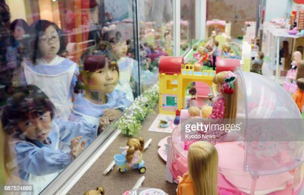 Children look at a display at Liccachan Castle a theme park in the town of Ono in Fukushima Prefecture on May 6 2017 Liccachan Japan's longselling...
