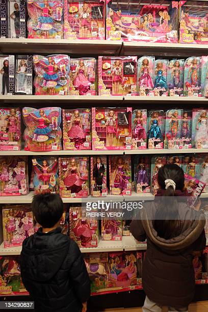 Children look at Barbie dolls on November 30 in a toys store in Paris less than one month before Christmas AFP PHOTO/ PIERRE VERDY
