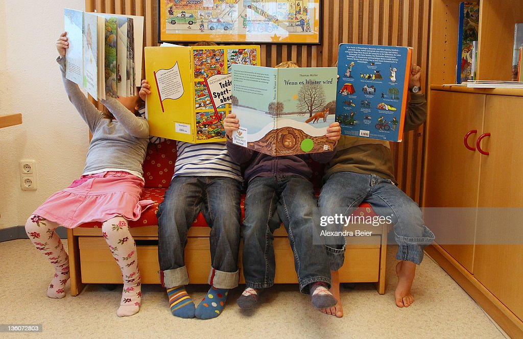Children look at books at a day care center for children aged 12 months to six years on December 22, 2011 in Munich, Germany. German authorities claim the country will need to increase the capacity of its child day care centers by at least an additional 230,000 by 2013.