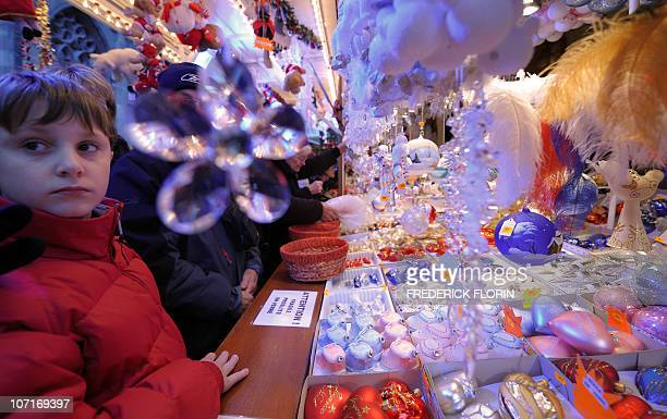 Children look at Christmas decorations on November 27 2010 during the opening of the Strasbourg Christmas market which is the largest and one of the...