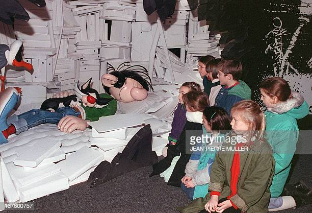 Children look at comics strip character Gaston Lagaffe 28 January 1989 at the Angoulême comics show Gaston Lagaffe who made his first apparition in...