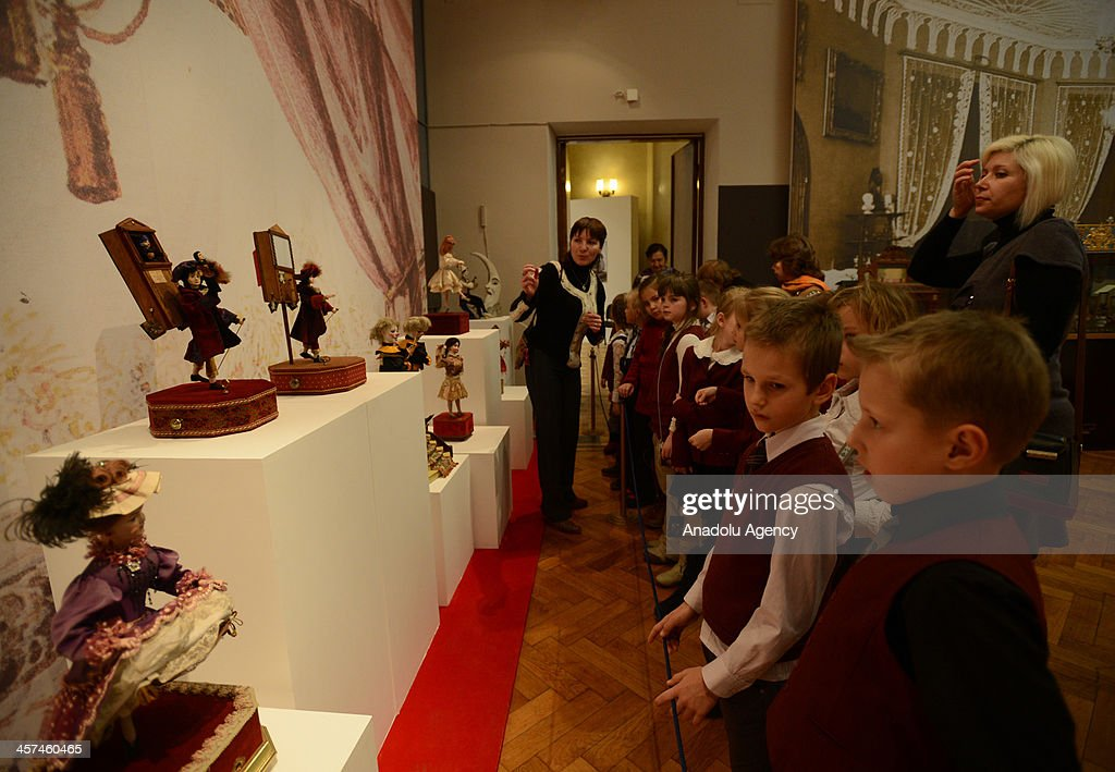 Children look at Mechanical Musical Instruments and Dolls of the 19th and 20th Centuries from the Collection of Russian businessman David Yakobashvili is held at Museum of Folk Arts on December 16, 2013 in the capital of Russia, Moscow. It is open to the public between December 11, 2013 January 26, 2014. Dolls depicted people engaged in some work: girls playing musical instruments, dancing circus artists or musicians. Dolls with porcelain faces and hands, dressed in expensive fabrics at The Dance of Palace Dolls named show.