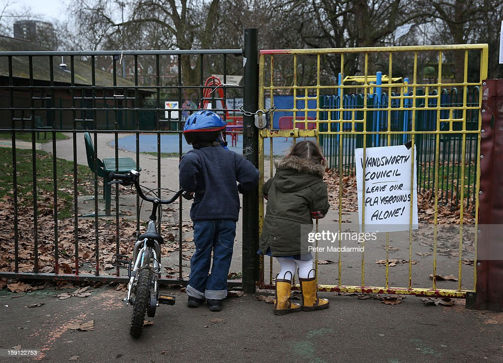 Children look into a closed playground next to Battersea Park adventure playground on January 8, 2013 in London, England. Activists and local residents oppose local authority plans to demolish the adventure playground, which has been mostly used by teenagers, and replace it with facilities for younger children who will need less supervision.