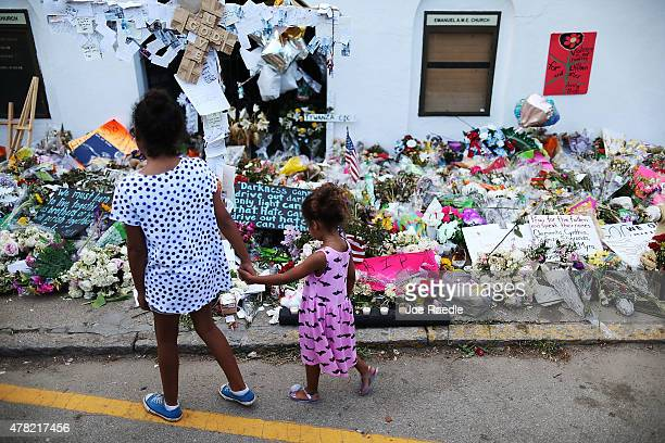 Children look on at the memorial in front of the Emanuel African Methodist Episcopal Church on June 23 2015 in Charleston South Carolina Dylann Roof...