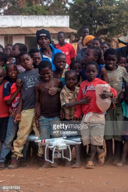 Children look on during a drone awareness and safety demonstration on June 22 in regards to humanitarian drone corridor testing under the...