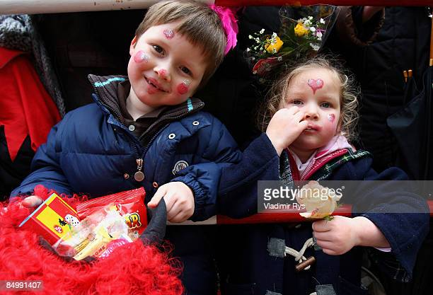 Children look on during the 'Rose Monday' traditional carnival in Rhine area on February 23 2009 in Cologne Germany
