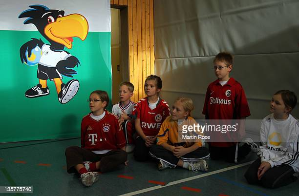 Children look on during the Women's German Indoor Cup press conference on December 14 2011 in Magdeburg Germany