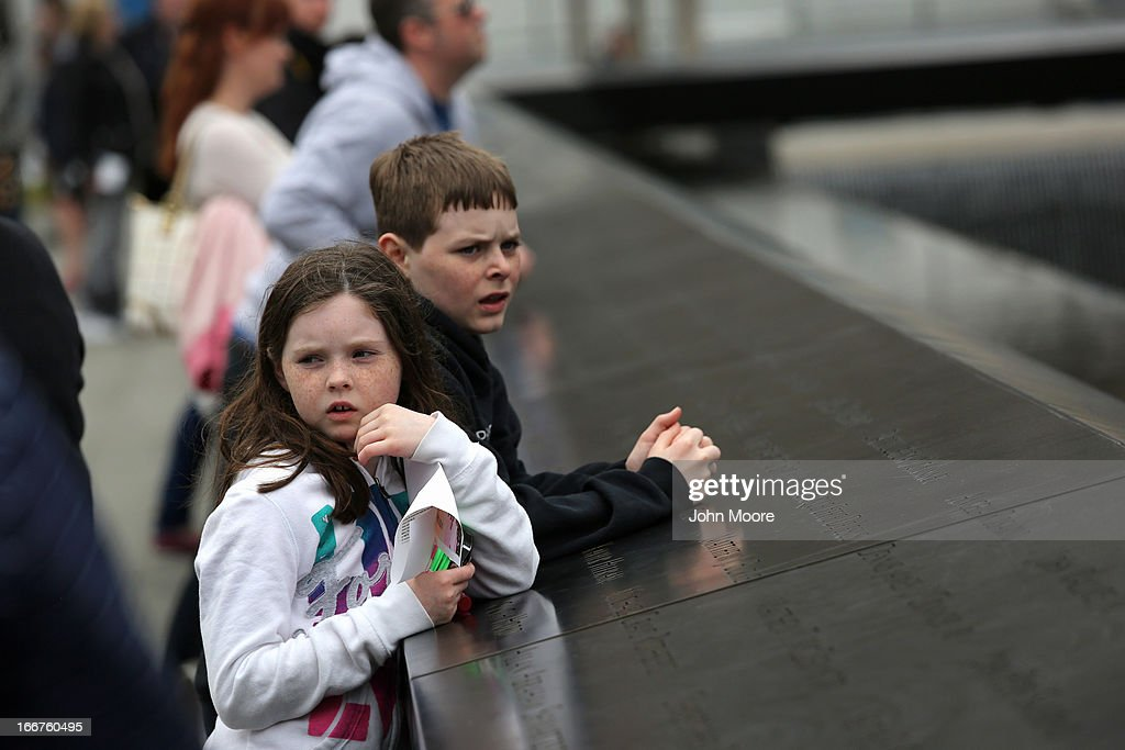 Children look over the September 11 Memorial and Museum on April 16, 2013 in New York City. Security was high throughout New York City a day after the Boston Marathon attacks.