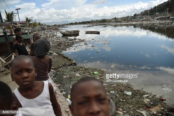 Children look the camera next to Mapou River in Shadaa neighborhood in CapHaitien in the north of Haiti 240 km from PortauPrince ahead of Hurricane...