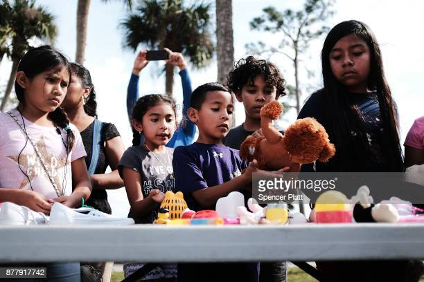 Children look through donated toys at the annual Thanksgiving in the Park gathering where residents of the farm worker community of Immokalee are...