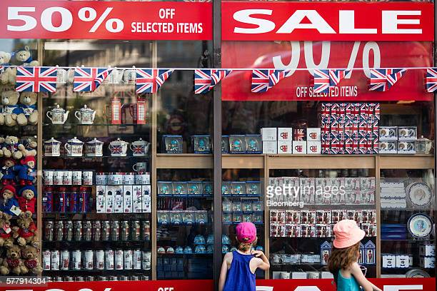 Children look through the window of a souvenir shop selling British branded goods on the Haymarket in London UK on Tuesday July 19 2016 UK inflation...