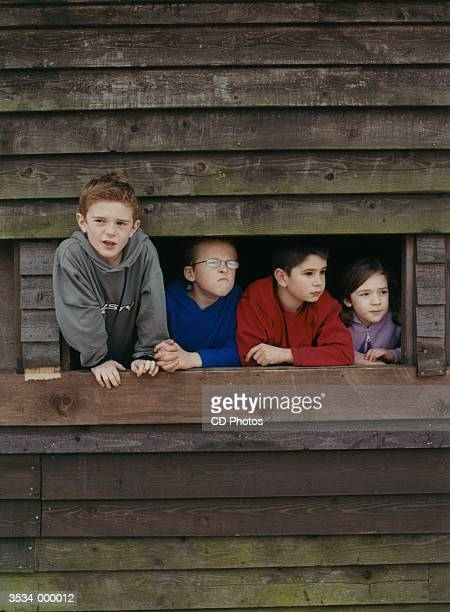 Children Looking Out of Hut