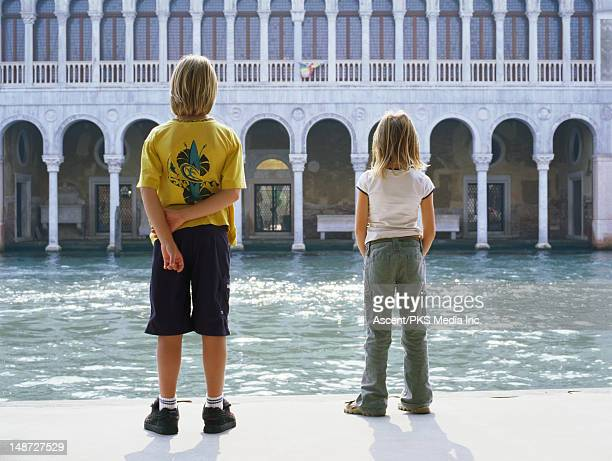 Children looking over canal.