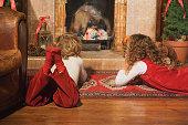 Children lying near fireplace