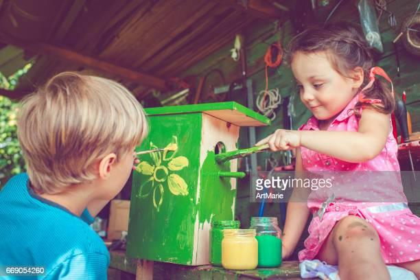 Children make and paint birdhouse