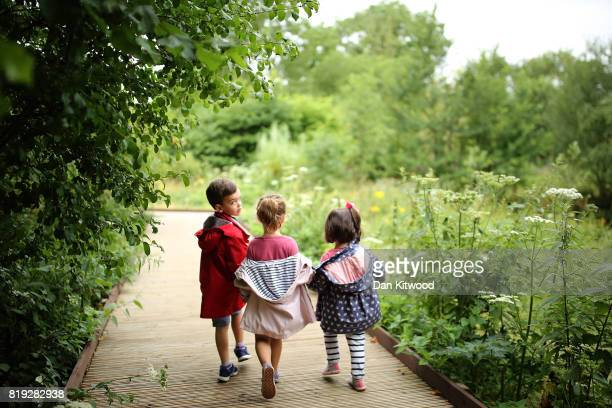Children make their way along a boardwalk during a photocall at Kew Gardens on July 20 2017 in London England The Kew Gardens Summer festival...