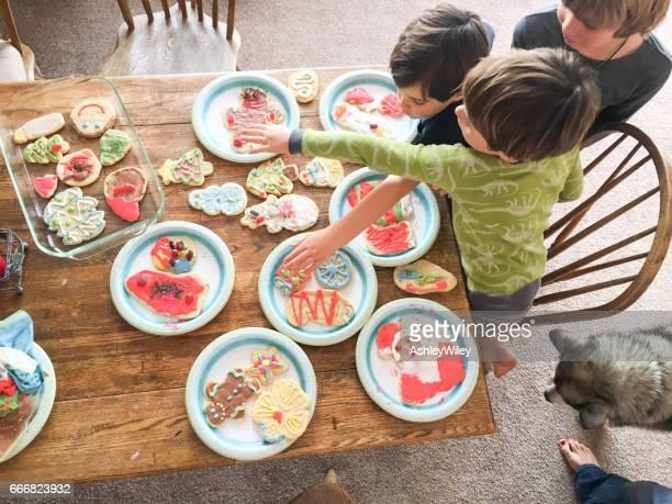 children making and sharing sugar cookies