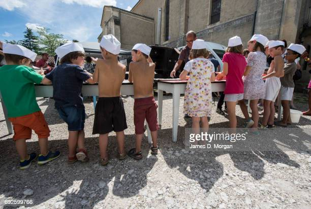 Children making bread at a local fair on June 5 2017 in Saussignac France Monday is a public holiday in France to celbrate the day after Pentecost...
