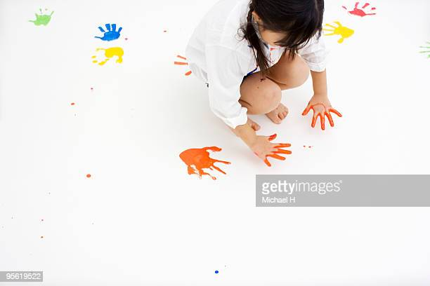 Children Making Handprints With Paint