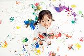 Children Making Handprints With Paint