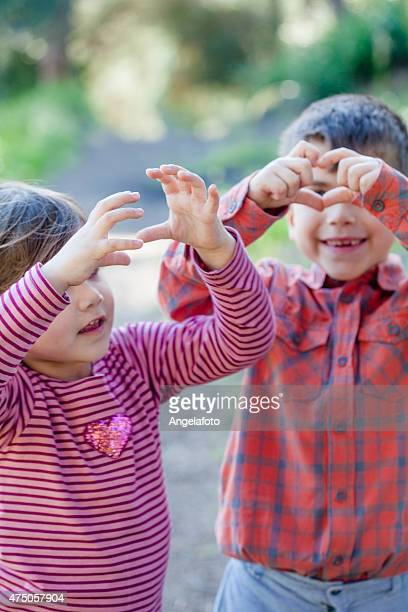 Children making Heart Shape with Hands