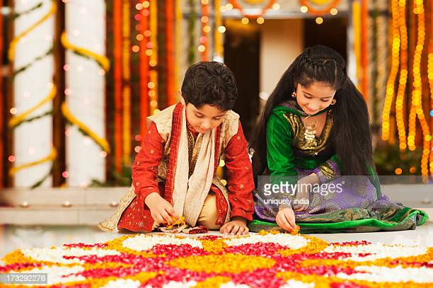 Children making rangoli on Diwali