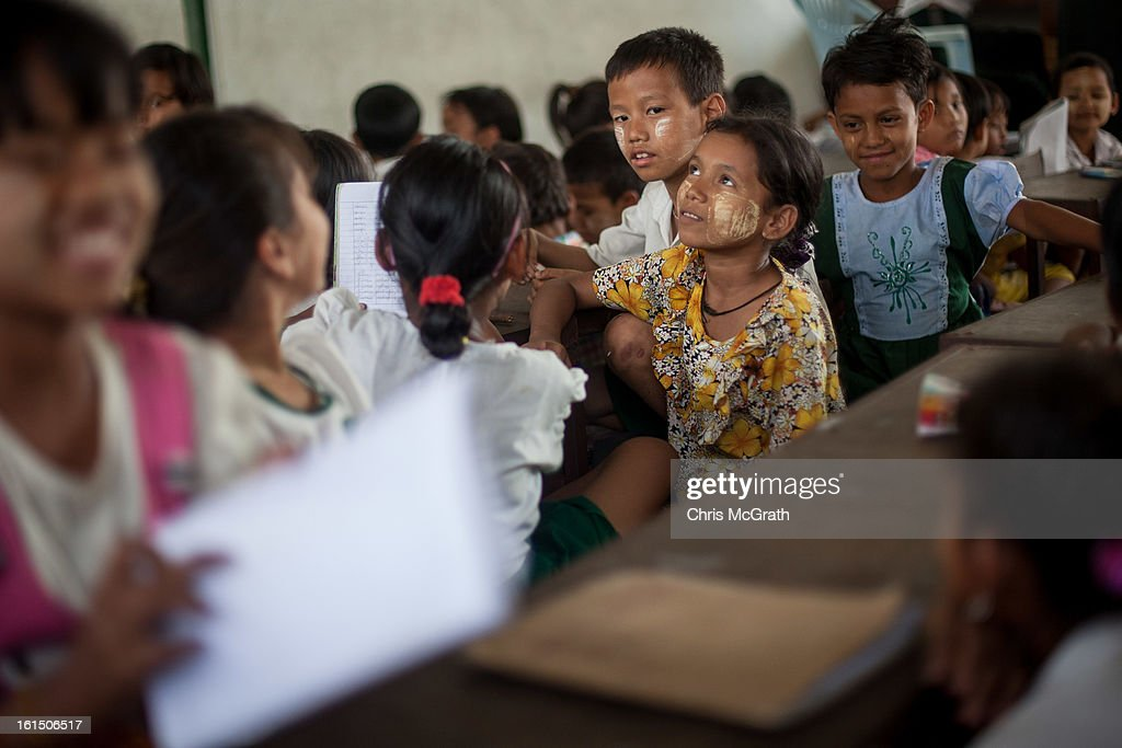 Children, many of which come from poor areas or are orphans learn Burmese at the Ahlal Taik Monastery School in Dala Township on February 11, 2013 in Yangon, Burma. As the country goes through sweeping political and economic reforms, many are hopeful that after decades of neglect the healthcare system will also benefit from the changes. Although health budgets have increased the state health system is still underfunded and struggles to provide basic healthcare as well as essential medicines for treating HIV, Malaria and TB. With sanctions being lifted it is hopeful that again the flow of medical equipment, medicines and the presence of NGO's will increase.