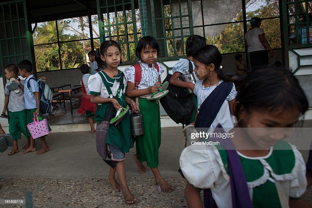 Children, many of which come from poor areas or are orphans leave the classroom after school at the Ahlal Taik Monastery School in Dala Township on February 11, 2013 in Yangon, Burma. As the country goes through sweeping political and economic reforms, many are hopeful that after decades of neglect the healthcare system will also benefit from the changes. Although health budgets have increased the state health system is still underfunded and struggles to provide basic healthcare as well as essential medicines for treating HIV, Malaria and TB. With sanctions being lifted it is hopeful that again the flow of medical equipment, medicines and the presence of NGO's will increase.