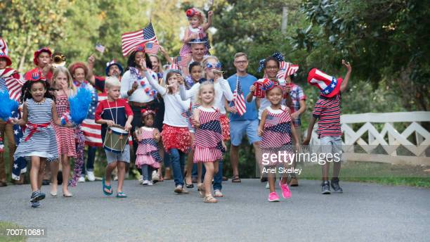 Children marching in 4th of July parade in park