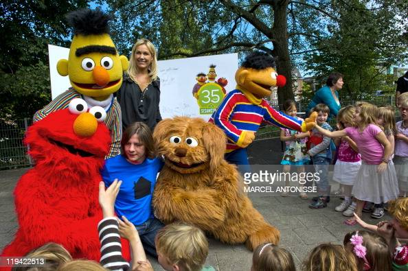 Children mark the 35th anniversary of Sesame Street flanked by Sesame Street characters Elmo Tommie Bert and Ernie at the Dalton School in Amsterdam...