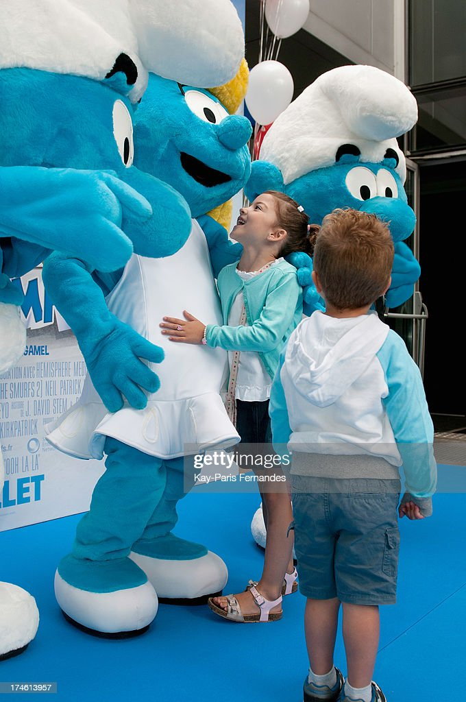 Children meet and pose for photos with the Smurfs at the 'Smurfs 2' Paris Premiere at UGC Cine Cite Bercy on July 28, 2013 in Paris, France.