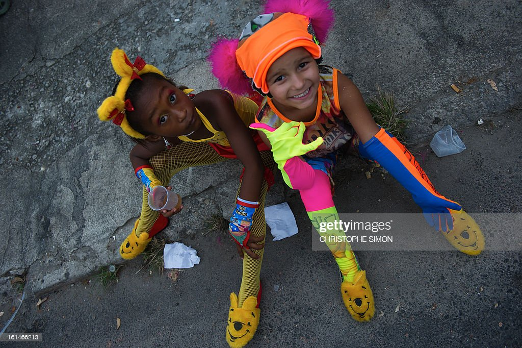 Children members of the local 'Indio' carnival group of the Guadalupe neighborhood in northern Rio de Janeiro, Brazil, await to take part in their 'Bate Bola' traditional parade on February 10, 2013. AFP PHOTO/Christophe Simon