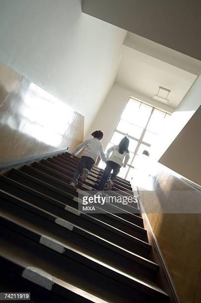 Children moving up staircase