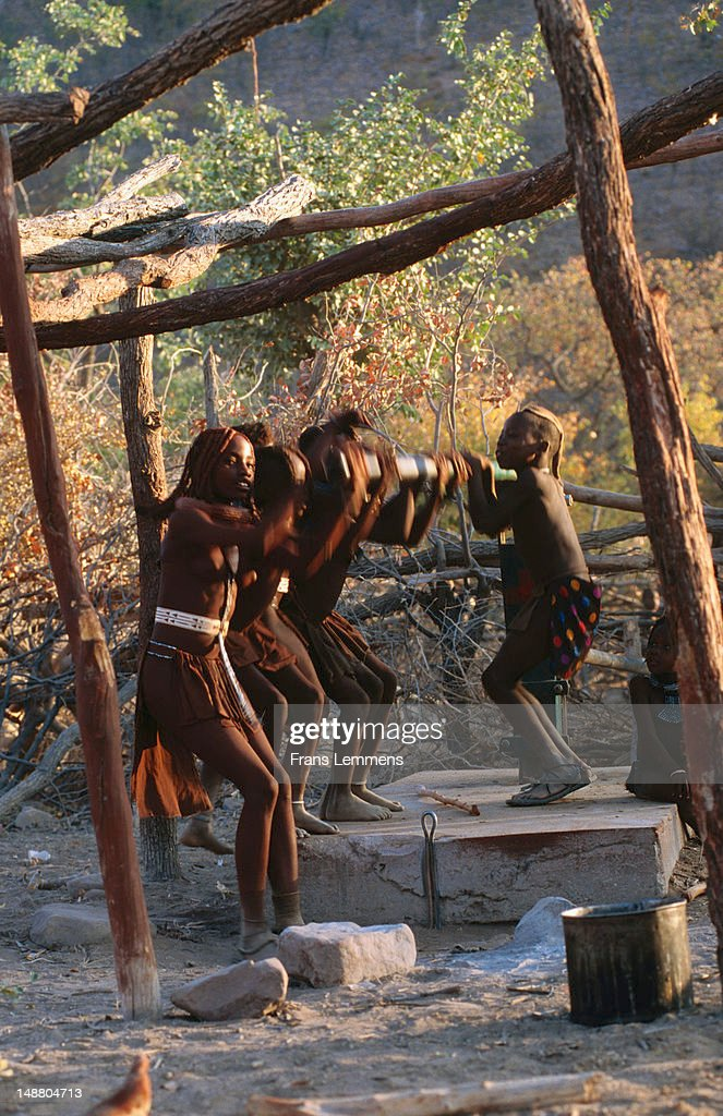 Children of Himba tribe pumping water. : Stock Photo