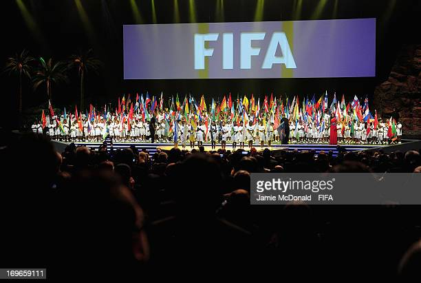 Children of Mauritius carry the countries of the world's flags during the 63rd FIFA Congress opening ceremomy at the Swami Vivekananda International...