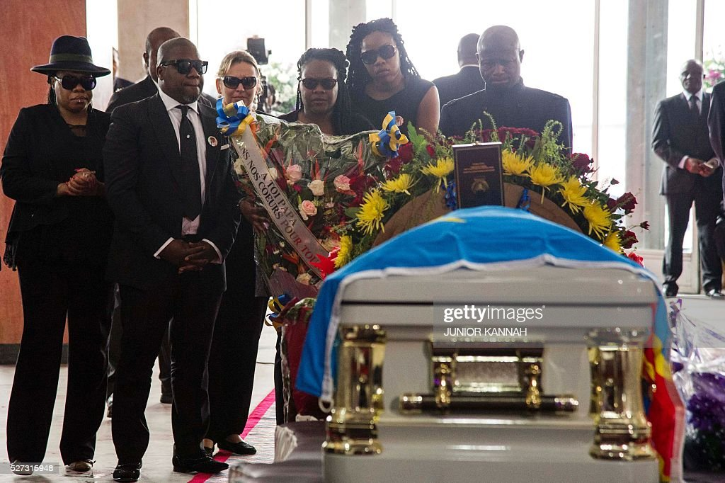 Children of rumba musician Papa Wemba pay their respects during his funeral in Kinshasa on May 2, 2016. Democratic Republic of Congo's rumba king Papa Wemba was posthumously awarded one of his country's highest honours, a week after he collapsed on stage and died aged 66. / AFP / JUNIOR