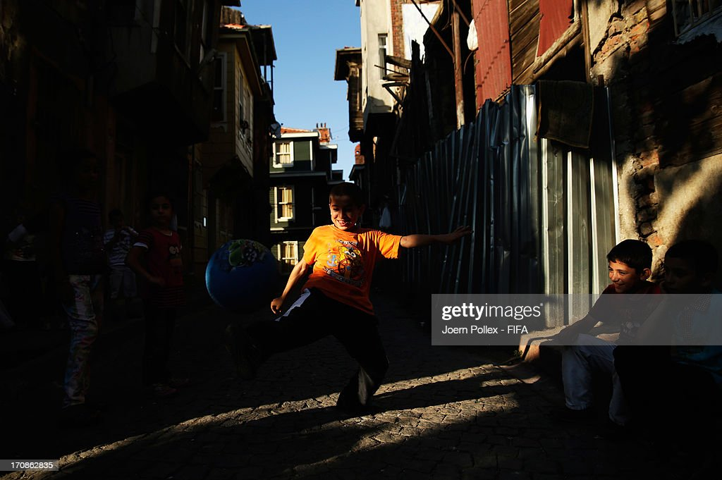 Children of the Fatih/Istanbul Province enjoy a game of street football on June 19, 2013 in Istanbul, Turkey.