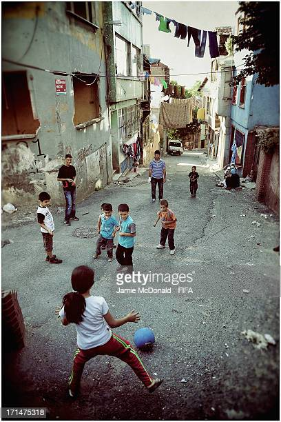 Children of the Fatih/Istanbul Province enjoy a game of street football on June 19 2013 in Istanbul Turkey
