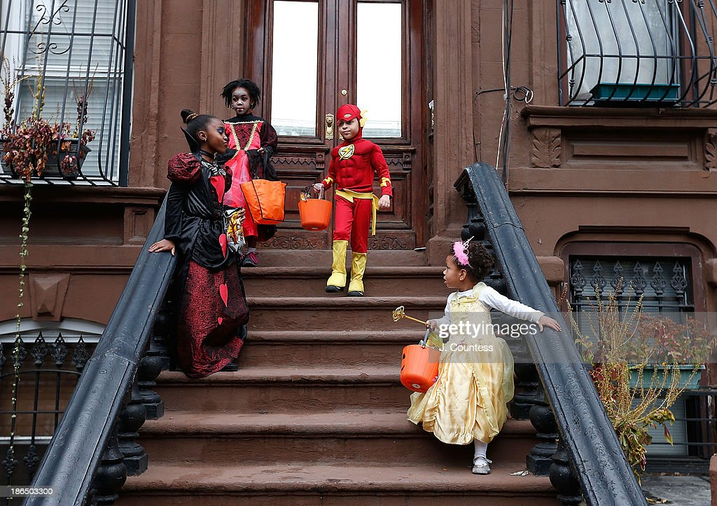 Children of the Jefferson Village Block Association 'Trick or Treat' at local residences in BedfordÐStuyvesant, Brooklyn on October 31, 2013 in New York City.