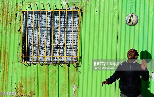 Children of the Khayelitsha Township near Cape Town enjoy a game of football on June 9 2010 in Cape Town South Africa