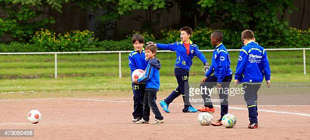 Children of the TSV Wandsetal play during the visit of Minister Of State For Migration Refugees And Integration Aydan Oezoguz May 12 2015 in Hamburg...